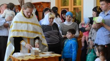 Baptizing at the orthodox church — Stock Video