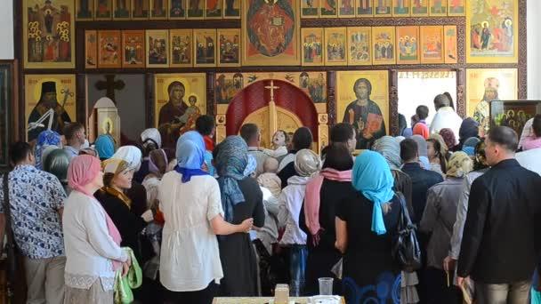 Baptizing at the orthodox church — Vídeo de stock