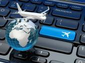 Online ticket booking. Airplane and earth on laptop keyboard. — Stock Photo