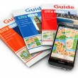 GPS mobile phone navigation and travel guide books. — Stock Photo #52345595