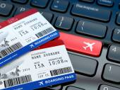 Online ticket booking. Boarding pass on laptop keyboard. — Stock Photo