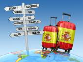 Travel concept. Suitcases and signpost what to visit in Spain. — Stockfoto