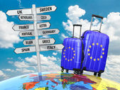 Travel concept. Suitcases and signpost what to visit in Europe. — Stock Photo