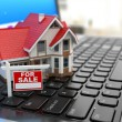 Real estate agency online. House on laptop keyboard. — Stock Photo #53712453