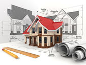 House on the drafts in different projections and blueprints. — Stock Photo