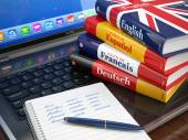 E-learning. Learning languages online. Dictionaries  on laptop. — Stock Photo