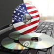 Software made in USA CD on laptop keyboard. Compact disks. — Stock Photo #54186663