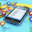 Travel destination and tourism concept. Smartphone on world map — Stock Photo #54186683