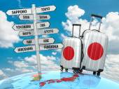 Travel concept. Suitcases and signpost what to visit in Japan. — Stock Photo