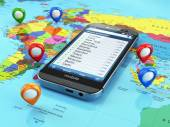 Travel destination and tourism concept. Smartphone on world map — Stock Photo