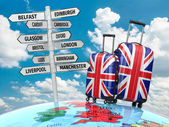 Travel concept. Suitcases and signpost what to visit in UK. — Stockfoto