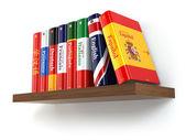 Dictionaries on bookshelf white isolated backgound. — Stock Photo