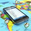 Travel destination and tourism concept. Smartphone on world map — Stock Photo #55251583