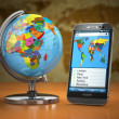 Travel and tourism concept. Mobile phone and globe. — Stock Photo #55251609
