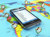 Travel destination and tourism concept. Smartphone on world map  — Foto de Stock