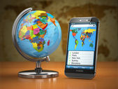 Travel and tourism concept. Mobile phone and globe. — Foto de Stock