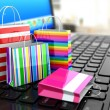 E-commerce. Online internet shopping. Laptop and shopping bags. — Foto de Stock   #55940147