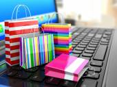 E-commerce. Online internet shopping. Laptop and shopping bags. — Stock Photo