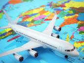 Airplane on world map. Three-dimensional image. — Stock Photo