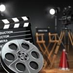 Video, movie, cinema concept. Retro camera, reels, clapperboard — Stock Photo #56412491