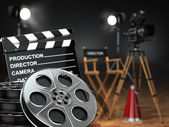 Video, movie, cinema concept. Retro camera, reels, clapperboard  — Stock Photo