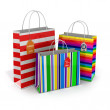 Colourful paper striped shopping bags isolated on white backgrou — Stock Photo #57005039