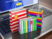 E-commerce concept. Colourful paper striped shopping bags on lap — Stock Photo