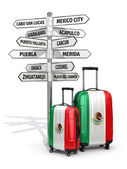 Travel concept. Suitcases and signpost what to visit in Mexico. — Stock Photo