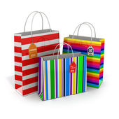 Colourful paper striped shopping bags isolated on white backgrou — Stock Photo