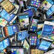 Mobile phones background. Pile of different modern smartphones. — Stock Photo #57593913