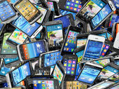 Mobile phones background. Pile of different modern smartphones. — Stock Photo