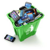Mobile phones in trash can isolated on white background. Utiliza — Stock Photo