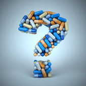 Pills or capsules as a question mark on blue background — Stock Photo