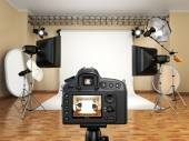 DSLR camera in photo studio with lighting equipment, softbox and — Stock Photo