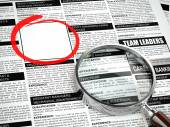 Job search concept. Loupe, newspaper with employment advertiseme — Stock Photo
