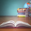 Concept of education. Open book wich pencils and globe. — Stock Photo #63155651