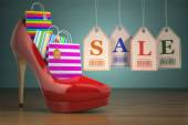 Shopping bags in women high heel shoes and labels sale. Concept  — Stock Photo