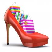 Shopping bags in women high heel shoes. Concept of consumerism. — Stock Photo