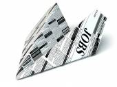 Job seeking concept. Newspaper as paper airplane. — Stock Photo