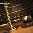 Justice concept. Gavel,  golden scales and books in the library  — Stock Photo #66150077