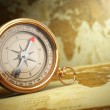 Vintage compass on the old world map. Travel concept. — Stock Photo #68778113