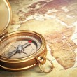 Vintage compass on the old world map. Travel concept. — Stock Photo #69482117