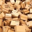 Stack of cardboard delivery boxes or parcels. Warehouse concept — Stock Photo #71255657