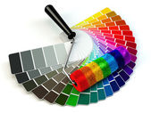 Roller brush and color guide palette in rainbow colors. — Stock Photo
