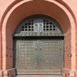 Old metal reinforced big door in fortress — Stock Photo #53810305