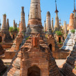 Ruins of ancient Burmese Buddhist pagodas — Stock Photo #53813381