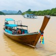 Traditional wooden boat against tropical background — Stock Photo #60151011