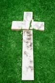Fallen and broken down marble cross — Stock Photo