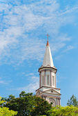 High tower turret of the church under blue sky — Stock Photo