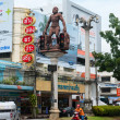 Intersection in central Krabi Town, with giant caveman statues, — Stock Photo #73412433